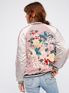 Floral Embroidered Bomber   Silky heavyweight bomber jacket with gorgeous floral embroidered details and stylish velvet accents. Ribbed material at the sleeve cuffs and collar.