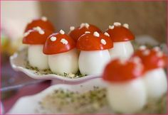 Deviled Egg Mushrooms. Make whole deviled eggs, Cap with tomato ends, sprinkle with Feta cheese. CUTE! #Food #eggs #tomatoes