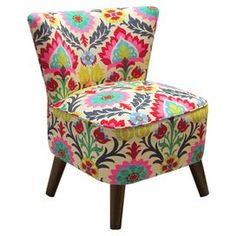 """Brimming with wayfaring appeal, this pine wood-framed accent chair showcases suzani medallion-print upholstery for bold style. Handmade in the USA.  Product: ChairConstruction Material: Solid pine, polyurethane and polyester fill foamColor: Cream, red, blue, yellow, pink, grey and greenFeatures:  Handmade in the USAFlared legsDimensions: 32"""" H x 24"""" W x 25"""" DCleaning and Care: Spot clean only"""