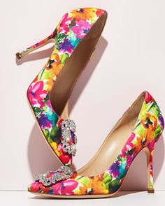"Only at NM: Only Here. Only Ours. Exclusively for You. Manolo Blahnik ""Hangisi"" floral-print fabric pump. 4.2"" covered heel. Pointed toe. Crystal buckle detail. Topstitched collar. Slip-on style. Leat"
