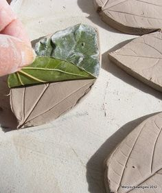 Ceramic leaves by Marylou Newdigate.