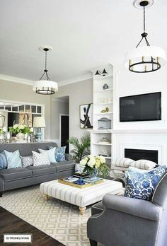 Elegant, Open Concept Living Room, With Grey Sofas And Drum Shade Pendant  Lights Create A Neutral Backdrop Of Layers Of Beautiful Blue Patterned  Pillows And ... Part 83