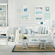 Crisp whites and shades of washed out blue were used to transform this bright beach cottage living room