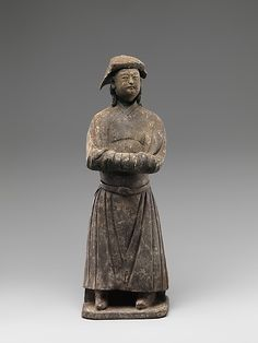 Figure of Mongol  Period:     Yuan dynasty (1271–1368) Date:     14th century Culture:     China Medium:     Pottery with burnishing