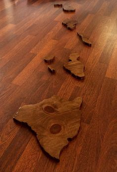 Wooden Hawaiian Island Chain Wall Art. Hand crafted with ALOHA and MADE IN HAWAII. Ships directly from O'ahu, Hawaii. This product is made from clear and knotty pine and is hand-crafted and designed to accurately depict the eight major Hawaiian Islands - Kaua`i, Ni`ihau, O`ahu, Moloka`i, Lana`i, Maui, Kaho`olawe, Hawai`i. Once the wood is carefully cut, each island is sanded, stained, and varnished for a smooth finish. All eight islands are included, along with mounting tape. The largest...