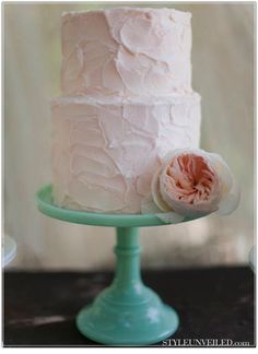perfect wedding cake. plain and simple and it looks like it is homemade.