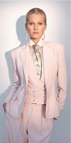 Ralph Lauren pink blazer. ---   Funny how fashion comes full circle...reminiscent early 70's style.  Fashionistas wore blazers with shirt, ties and high-waist baggy pants... yup, the 70's!