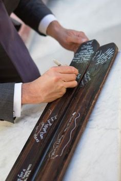 Use a pair of wooden skis used as wedding guestbook. | See more lodge #wedding details here: http://www.mywedding.com/articles/lodge-wedding-details/