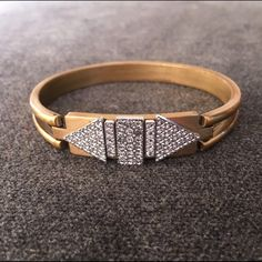 Anthropologie Art Deco Bangle Brass and crystal Art Deco bangle by Anthropologie. Opens and closes with clasp. No missing stones. Anthropologie Jewelry Bracelets