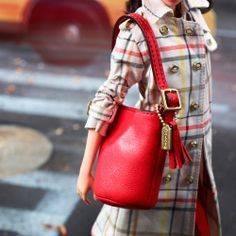 Coach Barbie with her iconic red duffle