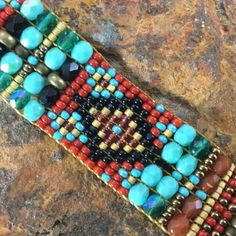 Black Arrow presents this beautiful & intricate Beaded Bracelet from Chili Rose Beadz with an impressive display of color, patterns w/ Red Garnet Center Stone