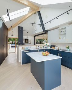 The homeowners of this family home had to be creative with their self-build when faced with a small plot and planning restrictions designing a 'sunken house' with a basement level filled with natural light. Explore this innovative home in our latest issue!  . Photo: Simon Maxwell . #homebuilding #selfbuild #design #ideas #architecture #archilovers #kitchen #livingroom #bedroom #bathroom #basement #kitchendesign #pendentlight #modern #contemporary #livingroomdesign #idea #home #navykitchen #colou