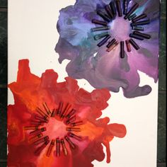 Crayon Art Flowers: Kept the board horizontal, first heated the crayons on low until they started to melt, placed the blow dryer end on high in the middle of the circle so the colors fanned out :)