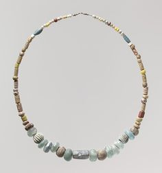 Beaded Necklace   Date: early 6th century  Geography: Made in Niederbreisig, Germany  Culture: Frankish  Medium: Glass, glazed earthenware (faience)    Classification: Glass-Beads