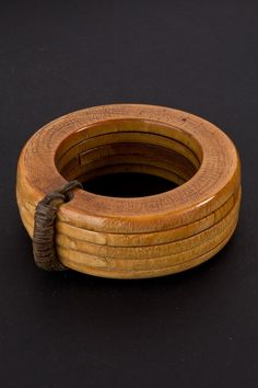 Africa | Five ivory bracelets bound together with a leather strap.  Bracelets like this are worn by Fon and Bamileke leaders during ceremonies.  Cameroon, early 1900s.