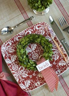 Holiday setting with individual wreaths at the door. Wreaths could be real or faux (just be cautious of sap on the plates) and represent the person who's to sit there.