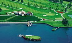 World's first floating golf course that sits in the middle of a lake... and can only be reached by boat. You had better make sure you hit the perfect shot if you want to make the 14th hole at this Idaho golf course. The Lake Coeur d'Alene course boasts with the world's only floating, moveable golf green which sits in the club's namesake. And if you manage to land your ball on the bobbing green, you'll have to catch a boat out to take your next shot.