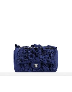 462dc4445d6 Neoprene flap bag embroidered with camellias. - CHANEL Leo di Caprio outbid  Paris Hilton to buy this for his Mom at a charity auction