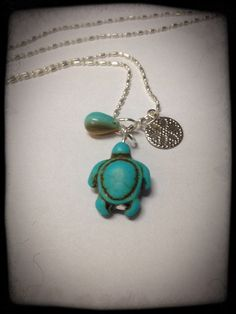 Turquoise Sea Turtle with a Silver Sand Dollar and a Turquoise Teardrop Necklace on Etsy, $25.00 CAD