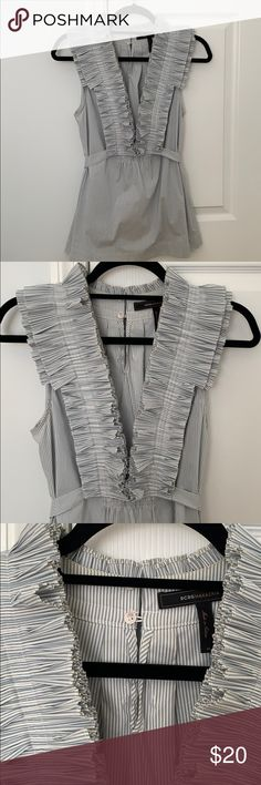 d8b2a65af2c43 Sleeveless Top with Pleated Ruffles Blue and white pinstriped top. Deep V  front with tie around the waist.