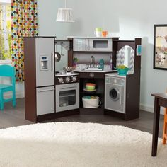 Now THAT is a play kitchen. It's nicer than my real kitchen lol Espresso Ultimate Corner Play Kitchen by KidKraft on Wooden Play Kitchen Sets, Kids Play Kitchen, Toy Kitchen, Toddler Kitchen Set, Real Kitchen, Indoor Playhouse, Build A Playhouse, Play Kitchens, Santas Workshop