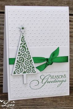 handmade Christmas card from Creative Crafts by Lynn: Git 'er Done Christmas Card ... clean and simple ... green and white ... Memory Box triangle tree with flourishes ... green grosgrain ribbon panel wrap tied in a know ... luv it!