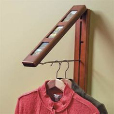 """Perfect for hanging wet clothes you don't want the dryer to shrink!     Closed, it's a picture frame just 2-1/4"""" thick. When you need extra hanging space, simple swing open the front and pull out the 12"""" chrome-plated steel clothes rod. It holds up to 50 lbs."""