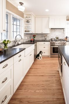 Kitchen remodel by Sicora Design Build: white cabinets, wood floors