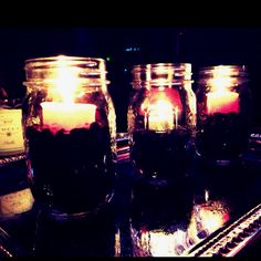 The power of Pinterest!! I repinned an idea of mason jars as candle holders a few days ago, and was spontaneously inspired to make my own tonight. And here they are, looking like a million bucks! (just coffee beans and 50 cent votives inside the jars.) I popped them on a fake silver tray for reflection and voila! ...instant fabulosity.