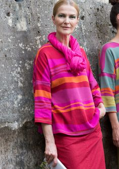 Jacquard knit jersey sweater features generous width in a vibrant, colorful undulating pattern. Comfortable fit with a slightly wider neckline and drop-shoulder three-quarter sleeves. A lovely accent color at the neckline makes a lovely detail.