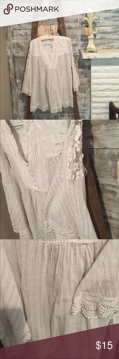 Free People White  Soft Lacey Top. Free People. Size small super cute with skinny jeans and leggings. Size small.  Runs a bit big. Very flowing.  Lace detail is very flattering and very comfy shirt. Free People Tops Tunics