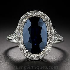 Antique Sapphire, Platinum and Diamond Ring, A deep, dark and mysterious midnight-blue oval sapphire, weighing 3.50 carats, is enshrined in a masterfully handcrafted platinum and diamond mounting dating from the Edwardian/early-Art Deco design period - circa 1910~early 1920s.