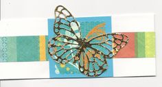 """Belly band for envelope card.  2 1/2"""" white band topped with a 1"""" print band.  2 1/2"""" x 2 1/4"""" card stock.  Die cut scalloped square 2"""".  Gold butterfly punch."""