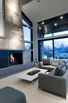 Cool mountain fireplace with contemporary sofas
