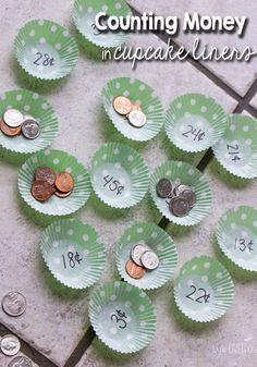 Counting money game using cupcake liners.  So cute and easy!