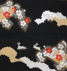 This furoshiki features bunnies and cherry blossoms on a black base. Gold and metallic silver and white and vermilion combine in this striking motif.Please note that the gold and silver portions of th