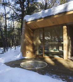 forest-getaway-cabin-dominated-by-warm-wood-boards-3-patio.jpg