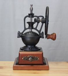 """Antique style coffee bean grinder Cast iron Black/Natural wood base Extremely sharp ceramic grinder core 10"""" H 5.00 lb"""