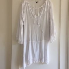 """Khush white blouse. Khush white blouse.  33""""from shoulder to hem.  Great to wear with jeans or tights. Very good condition.  Picture does not show how beautiful and flowing this top is. Tops Blouses"""