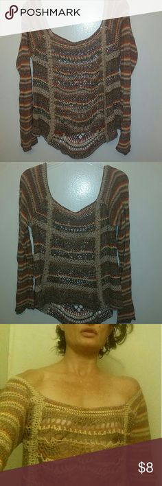 Free People crochet  multi colored sweater Free People crochet sweater. May be worn off the shoulders or on one shoulder/off the other. Various shades of brown, yellow, and orange. Size M. I'm SO ANNOYED! As I was folding this back up, I noticed the spot as seen in pic 4 (it's on the back of the arm, so I didn't notice it). I have no idea if it will come out or not, I imagine it will, and will try to make time to do it - but I'm pricing it cheaply in case I forget! Free People Sweaters