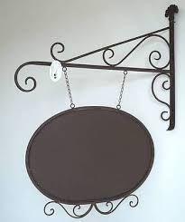 Resultado de imagen para carteles colgantes de hierro