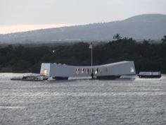View of the USS Arizona Memorial at Pearl Harbor, Oahu, Hawaii from aboard the USS John C. Stennis at dusk.