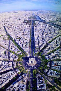 Place de l'Etoile with l'Arc de Triomphe and les Champs-Elysées, Paris. We recommend walking or taking the metro instead of driving. www.TheTripStudio.com