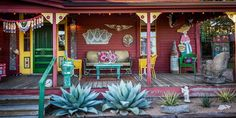 Paradise comes in many shapes and forms for different people, but give us a country ranch with 18th century barns, vintage neon signs, Frida Kahlo-influenced folk art and outdoor porches decorated with salvaged antiques and string lights? Let's just say, we'd be making ourselves quite comfortable...