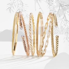 David Yurman bracelets in 18k yellow or rose gold.