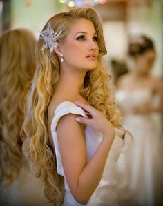 Another hair style idea...all down with beach curls and ornament in hair.
