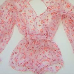 Long Sleeve Chiffon Butterfly Romper So pretty! Size large. All over baby pink with butterflies. Open back. Price is firm. Victoria's Secret Intimates & Sleepwear