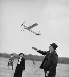 Robert Doisneau // France, Men playing with a scale down plane. 1950s ( http://www.gettyimages.co.uk/detail/news-photo/france-men-playing-with-a-scale-down-plane-news-photo/121517470