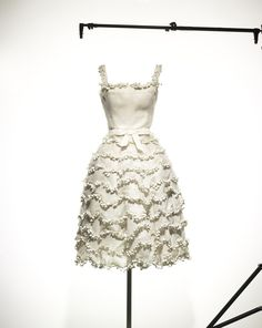 1957 Muguet short evening dress in white organdy embroidered with lily of the valley motifs, worn by Francine Weisweiller, haute couture Spring-Summer 1957, Libre line. Dior