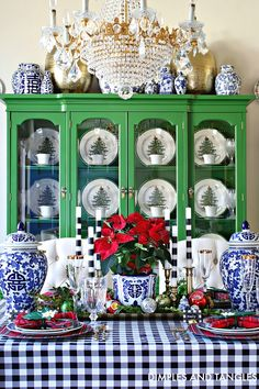 I would have never thought to use blue and white gingham at Christmas, but this totally Tablescape totally works! And how gorgeous is that bright green hutch showcasing a set of Spode Christmas China? Holiday Tablescape Inspiration with Old Southern Charm Tartan Christmas, Christmas China, Spode Christmas Tree, Christmas Tablescapes, Christmas Table Decorations, Christmas Home, White Christmas, Holiday Decor, Christmas Kitchen